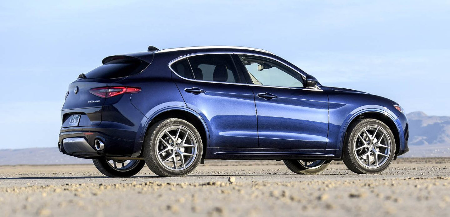 Display A blue 2021 Alfa Romeo Stelvio TI parked with mountains in the distance.